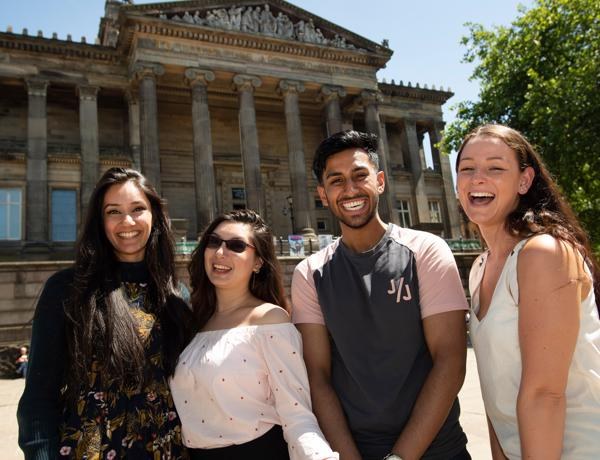 Group of students posing for a group photo in front of the Harris Museum, Preston