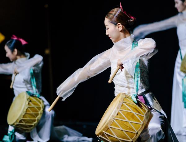 Korean dancers with instruments at the Lancashire Korea festival