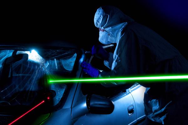 Forensic scientists work on a car