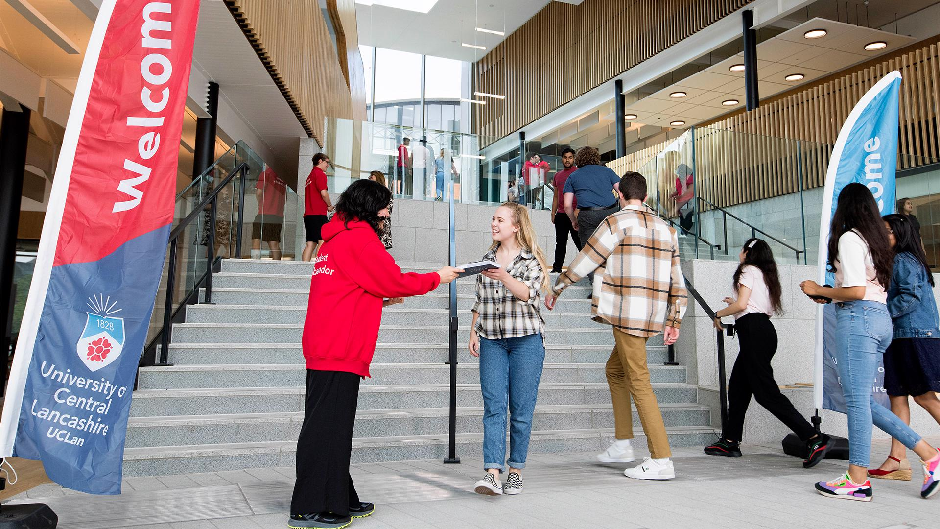 Student being greeted at an open day in the Student Centre