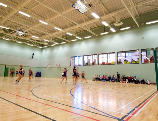 Netball match in the Sir Tom Finney Sports Centre
